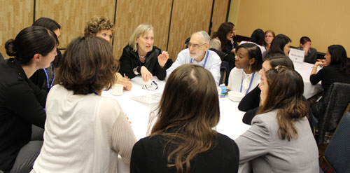 Claudia Goldin (Harvard, CSWEP Board 2001-04) and Robert Pollak (Washington University in St. Louis, CSWEP Board 2000-03) talk with junior economists about Research and Publishing at the  4th Annual Mentoring Breakfasts for Junior Economists