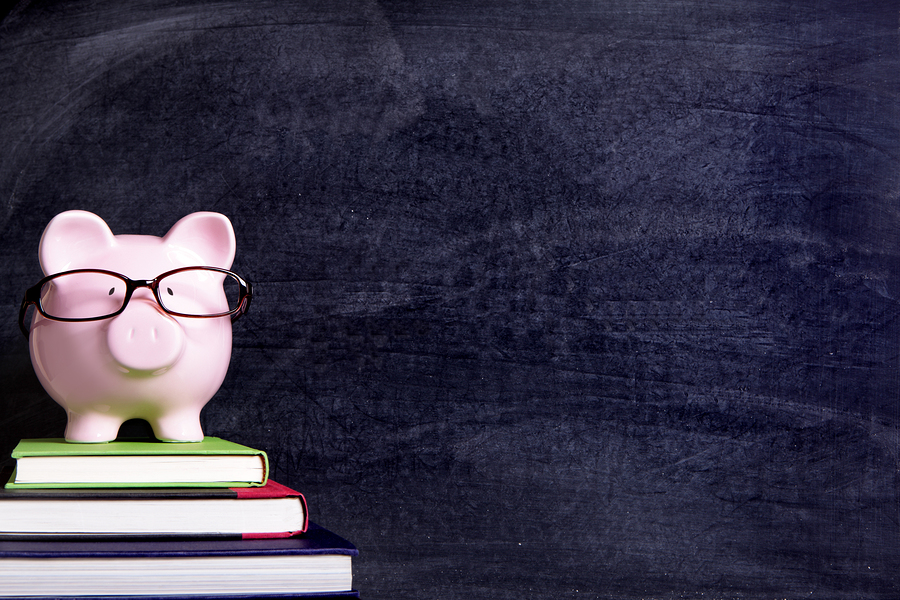 bigstock-Piggy-Bank-With-Glasses-And-Bl-117214469.jpg
